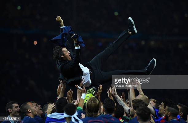 Luis Enrique manager of Barcelona is thrown in to the air by his players as they celebrate victory after the UEFA Champions League Final between...