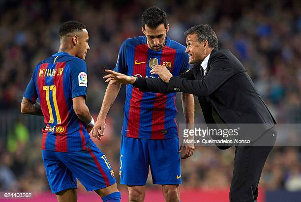Luis Enrique Manager of FC Barcelona give instructions to his players Sergio Busquets and Neymar JR during the La Liga match between FC Barcelona and...