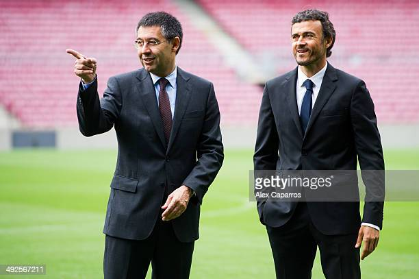 Luis Enrique Martinez looks on with President Josep Maria Bartomeu during his official presentation as the new coach of FC Barcelona at Camp Nou on...