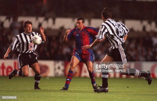 Luis Enrique of Barcelona takes on Newcastle United's John Beresford and Philippe Albert