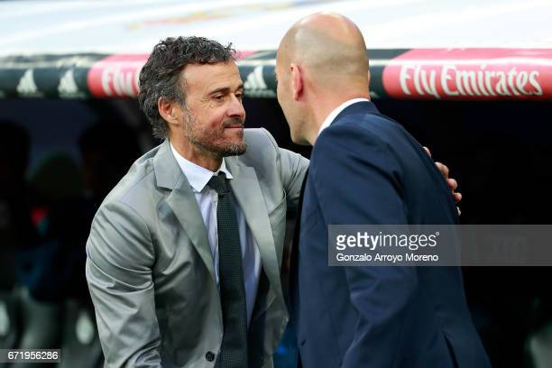 Luis Enrique the manager of Barcelona greets Zinedine Zidane head coach of Real Madrid prior to kickoff during the La Liga match between Real Madrid...