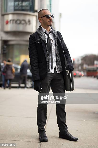 Luis Eulloqui is seen on Michigan Avenue wearing Guess glasses Express white shirt and black jacket Zara black tie and pants black leather Gino...