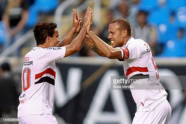 Luis Fabiano and Jadson of Sao Paulo celebrate a scored goal during a match between Sao Paulo and Botafogo as part of Serie A 2012 at Engenhao...