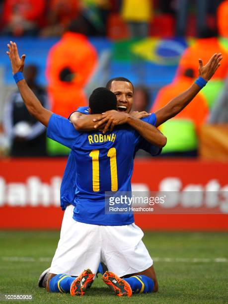 Luis Fabiano congratulates Robinho of Brazil after he scored the opening goal during the 2010 FIFA World Cup South Africa Quarter Final match between...