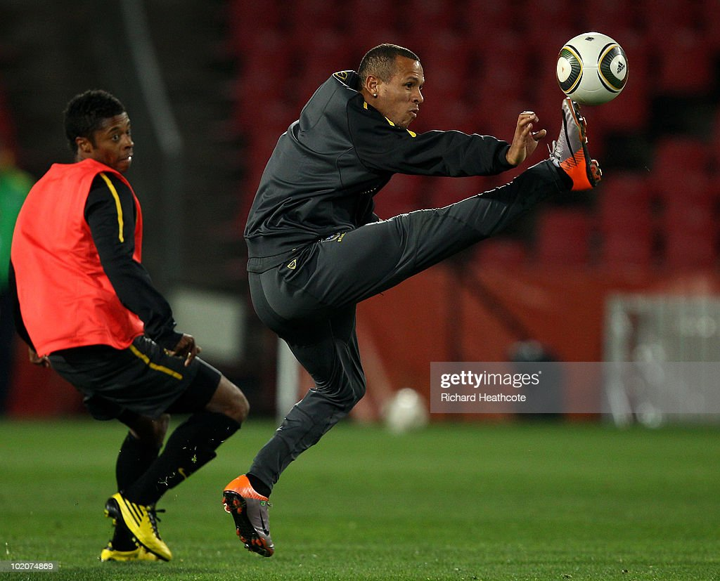 <a gi-track='captionPersonalityLinkClicked' href=/galleries/search?phrase=Luis+Fabiano&family=editorial&specificpeople=637040 ng-click='$event.stopPropagation()'>Luis Fabiano</a> controls the ball during the Brazil training session at Ellis Park on June 14, 2010 in Johannesburg, South Africa. Brazil will play their opening 2010 FIFA World Cup Group G match against Korea DPR on 15th June at the Ellis Park Stadium.