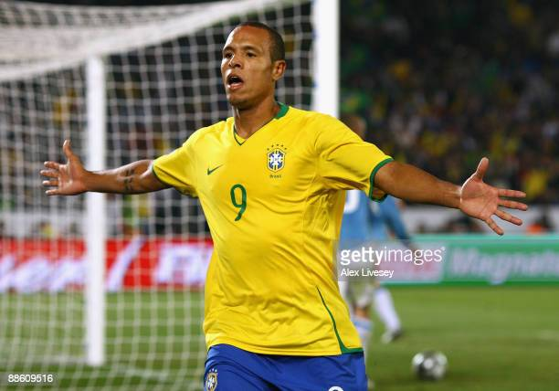 Luis Fabiano of Brazil celebrates after scoring his second goal during the FIFA Confederations Cup match between Italy and Brazil at the Loftus...