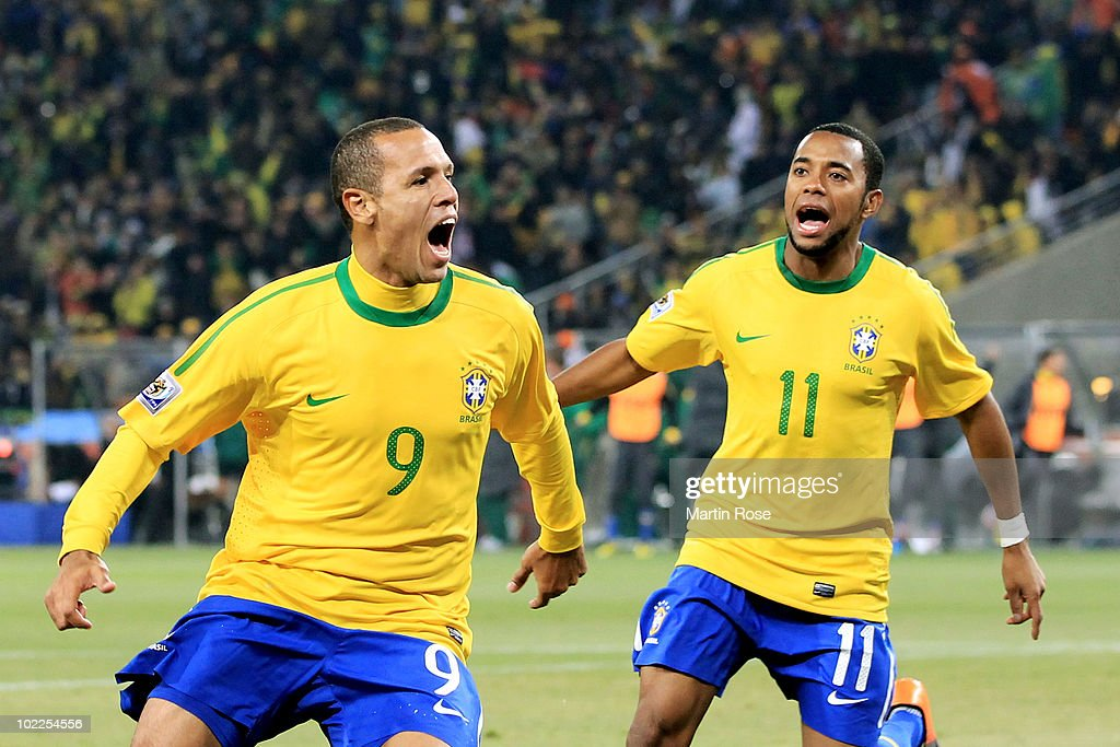 Luis Fabiano of Brazil celebrates scoring his second goal with team mate Robinho (R) during the 2010 FIFA World Cup South Africa Group G match between Brazil and Ivory Coast at Soccer City Stadium on June 20, 2010 in Johannesburg, South Africa.