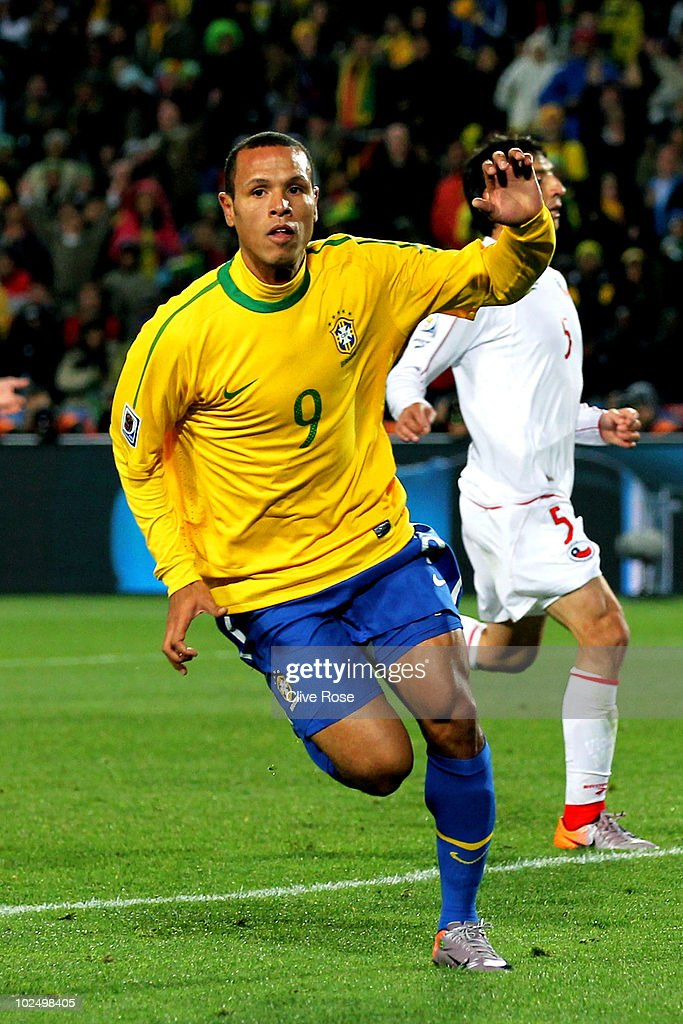 <a gi-track='captionPersonalityLinkClicked' href=/galleries/search?phrase=Luis+Fabiano&family=editorial&specificpeople=637040 ng-click='$event.stopPropagation()'>Luis Fabiano</a> of Brazil celebrates scoring his team's second goal during the 2010 FIFA World Cup South Africa Round of Sixteen match between Brazil and Chile at Ellis Park Stadium on June 28, 2010 in Johannesburg, South Africa.