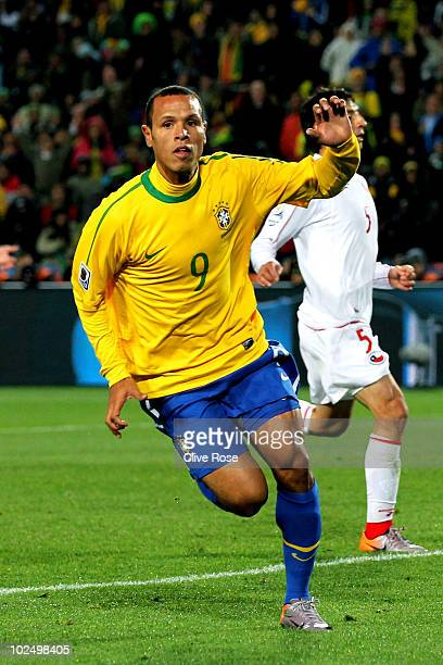 Luis Fabiano of Brazil celebrates scoring his team's second goal during the 2010 FIFA World Cup South Africa Round of Sixteen match between Brazil...