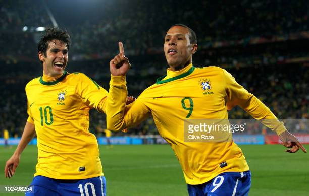 Luis Fabiano of Brazil celebrates scoring his team's second goal with team mate Kaka during the 2010 FIFA World Cup South Africa Round of Sixteen...