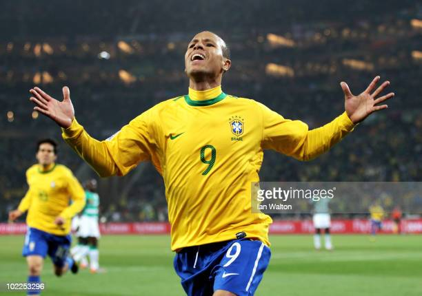 Luis Fabiano of Brazil celebrates scoring the opening goal during the 2010 FIFA World Cup South Africa Group G match between Brazil and Ivory Coast...