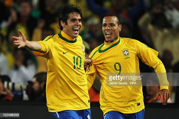 Luis Fabiano of Brazil celebrates scoring the second goal with teammate Kaka during the 2010 FIFA World Cup South Africa Round of Sixteen match...