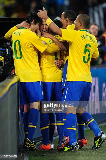 Luis Fabiano of Brazil celebrates scoring the second goal with team mates during the 2010 FIFA World Cup South Africa Group G match between Brazil...