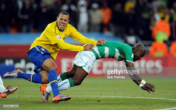 Luis Fabiano of Brazil clashes with Didier Zokora of the Ivory Coast during the 2010 FIFA World Cup South Africa Group G match between Brazil and...