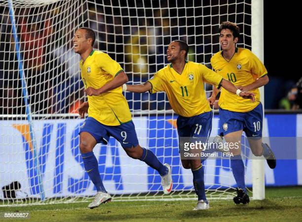 Luis Fabiano of Brazil is congratulated by his teammates Robinho and Kaka after scoring the opening goal for Brazil during the FIFA Confederations...