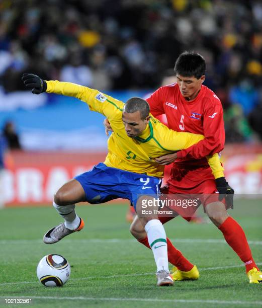 Luis Fabiano of Brazil is defended by Ri Kwang Chon of North Korea during the 2010 FIFA World Cup South Africa Group G match between Brazil and North...