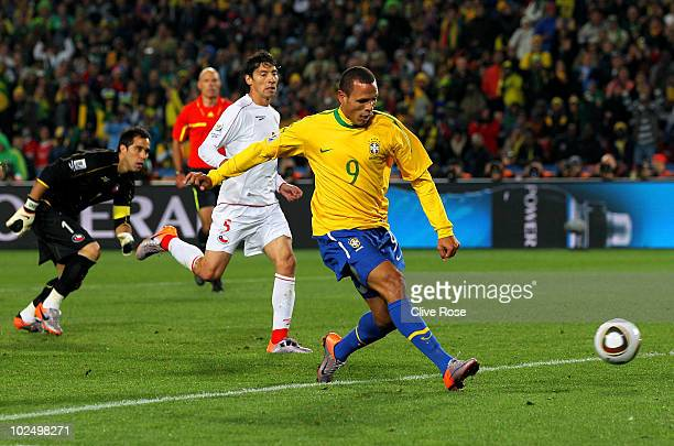 Luis Fabiano of Brazil scores his team's second goal during the 2010 FIFA World Cup South Africa Round of Sixteen match between Brazil and Chile at...