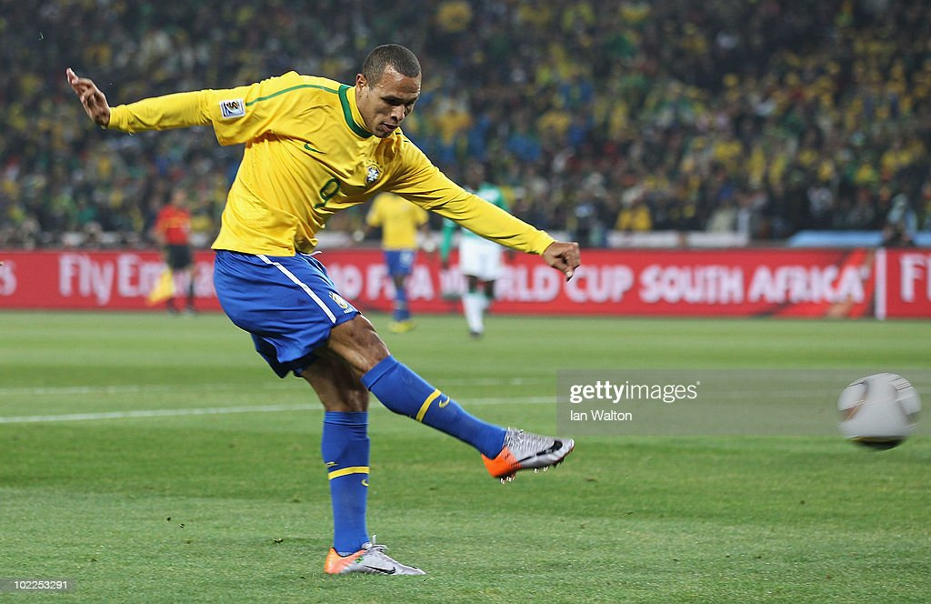 <a gi-track='captionPersonalityLinkClicked' href=/galleries/search?phrase=Luis+Fabiano&family=editorial&specificpeople=637040 ng-click='$event.stopPropagation()'>Luis Fabiano</a> of Brazil scores the opening goal during the 2010 FIFA World Cup South Africa Group G match between Brazil and Ivory Coast at Soccer City Stadium on June 20, 2010 in Johannesburg, South Africa.