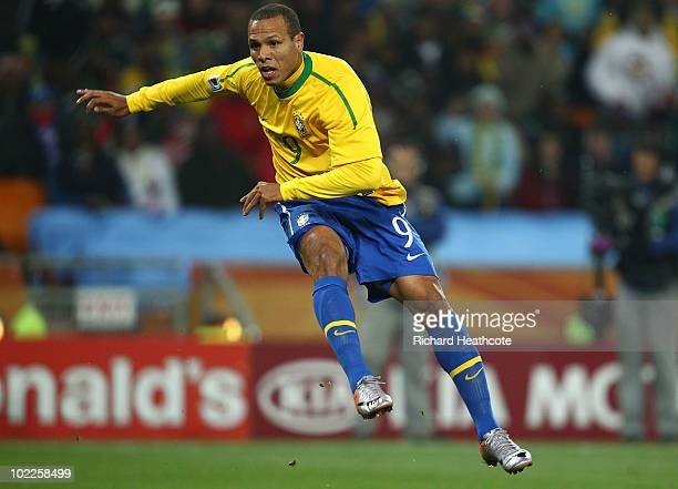 Luis Fabiano of Brazil scores the opening goal during the 2010 FIFA World Cup South Africa Group G match between Brazil and Ivory Coast at Soccer...