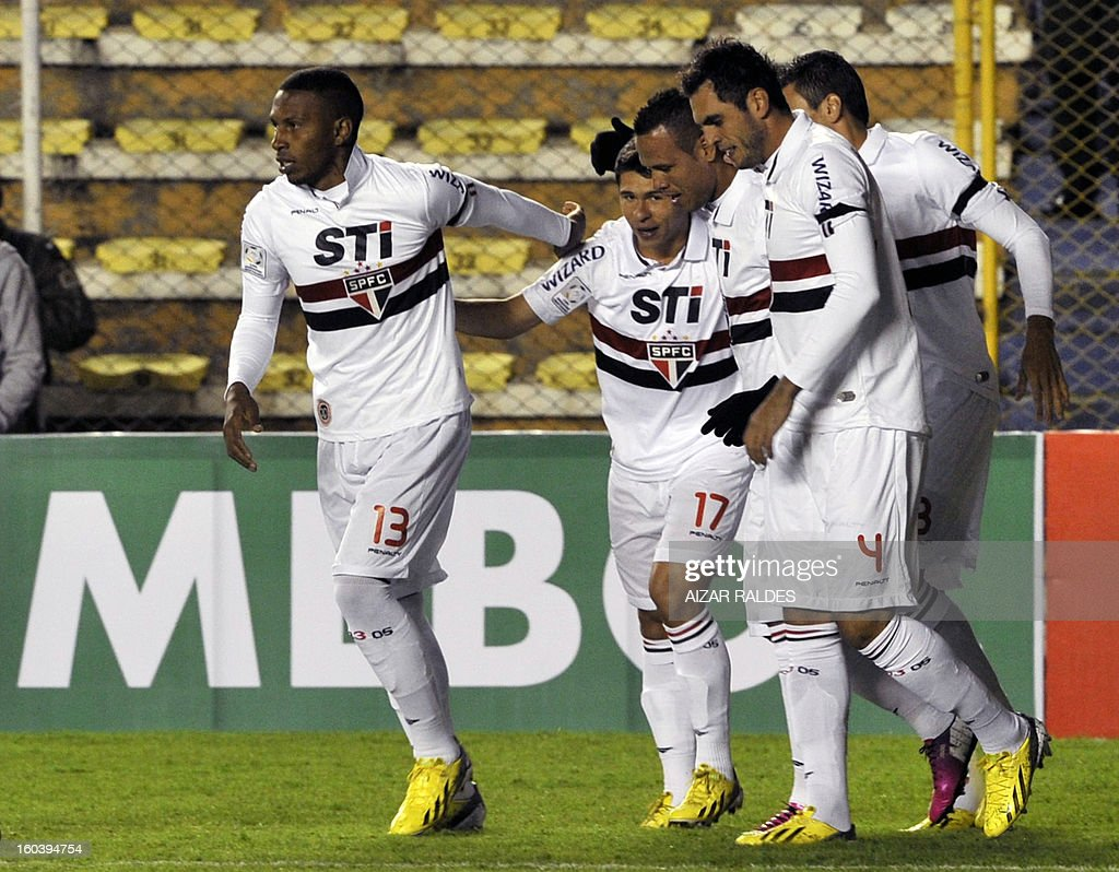 Luis Fabiano (3 R) of Brazil's Sao Paulo celebrates after scoring against Bolivia's Bolivar during their Copa Libertadores match at Hernando Siles stadium in La Paz, Bolivia, on January 30, 2013. AFP PHOTO/Aizar Raldes