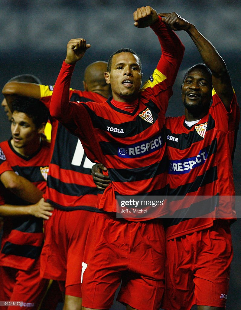 <a gi-track='captionPersonalityLinkClicked' href=/galleries/search?phrase=Luis+Fabiano&family=editorial&specificpeople=637040 ng-click='$event.stopPropagation()'>Luis Fabiano</a> (C) of Sevilla celebrates with <a gi-track='captionPersonalityLinkClicked' href=/galleries/search?phrase=Didier+Zokora&family=editorial&specificpeople=550698 ng-click='$event.stopPropagation()'>Didier Zokora</a> during the UEFA Champions League Group G match between Rangers and Sevilla at Ibrox Stadium on September 29, 2009 in Glasgow, Scotland.