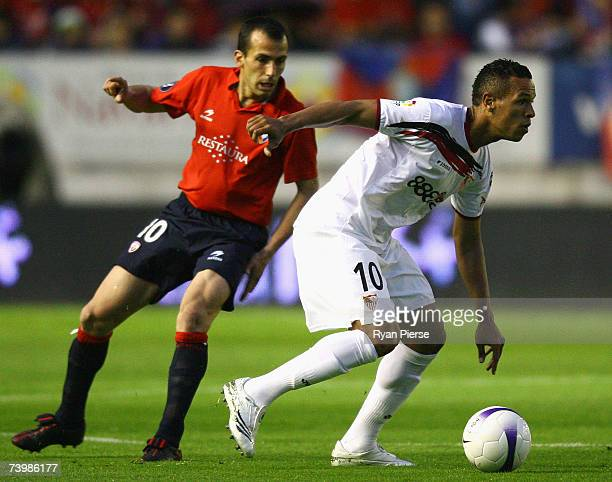 Luis Fabiano of Sevilla wins the ball over Patxi Punal of Osasuna during the UEFA Cup Semi Final first leg match between Osasuna and Sevilla at the...