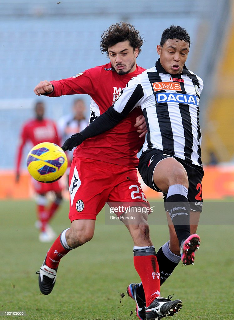 Luis Fernando Muriel Fruto (L) of Udinese Calcio competes with Matteo Contini of AC Siena during the Serie A match between Udinese Calcio and AC Siena at Stadio Friuli on January 27, 2013 in Udine, Italy.