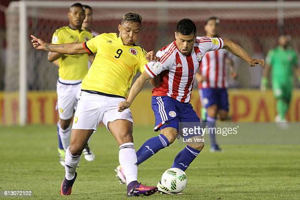 Luis Fernando Muriel of Colombia and Jorge Moreira of Paraguay struggle for the ball during a match between Paraguay and Colombia as part of FIFA...