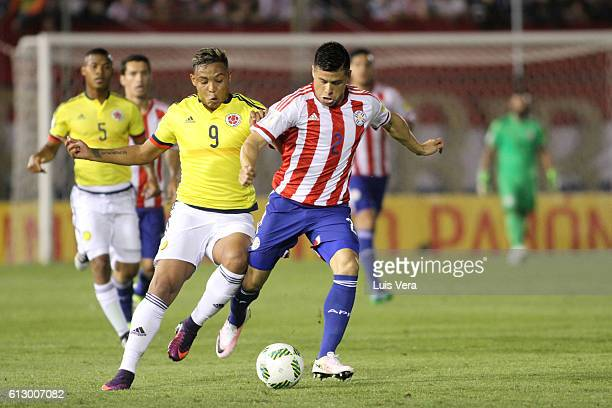 Luis Fernando Muriel of Colombia fights for the ball with Jorge Moreira of Paraguay during a match between Paraguay and Colombia as part of FIFA 2018...