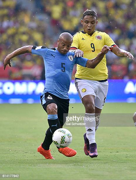 Luis Fernando Muriel of Colombia struggles for the ball with Carlos Sanchez of Uruguay during a match between Colombia and Uruguay as part of FIFA...