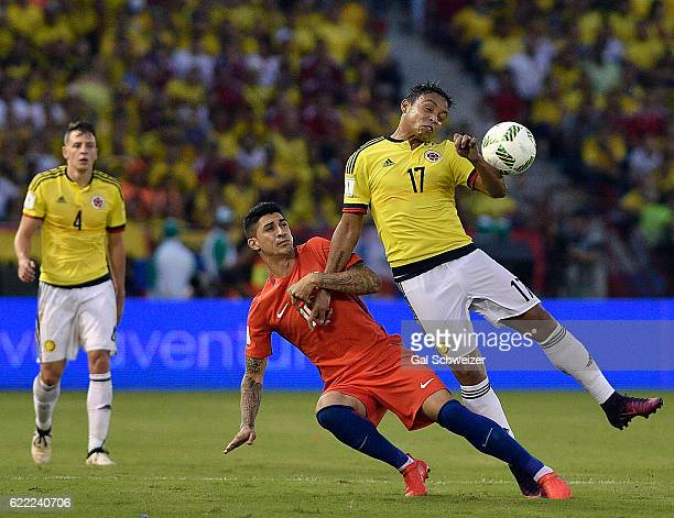 Luis Fernando Muriel of Colombia struggles for the ball with Eduardo Vargas of Chile during a match between Colombia and Chile as part of FIFA 2018...