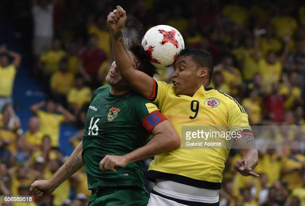 Luis Fernando Muriel of Colombia struggles for the ball with Ronald Raldes of Bolivia during a match between Colombia and Bolivia as part of FIFA...