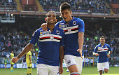 Luis Fernando Muriel of UC Sampdoria celebrates with his teammate Carlos Joaquin Correa after scoring the opening goal during the Serie A match...