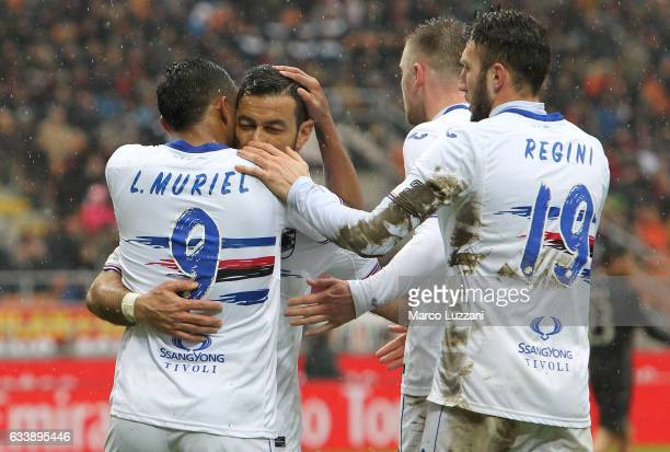 Luis Fernando Muriel of UC Sampdoria celebrates with his teammate Fabio Quagliarella after scoring the opening goal during the Serie A match between...