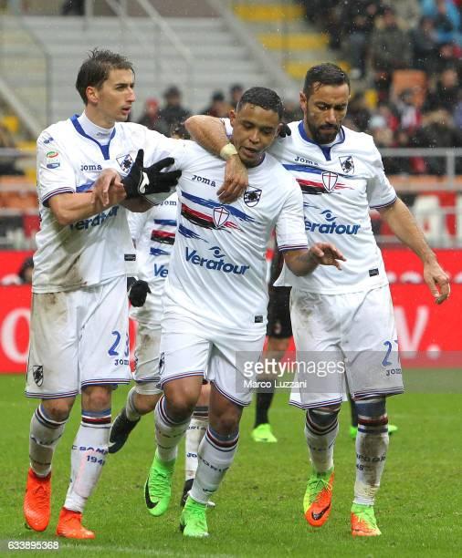 Luis Fernando Muriel of UC Sampdoria celebrates with his teammates Fabio Quagliarella and Filip Djuricic after scoring the opening goal during the...