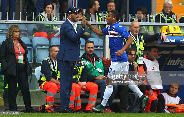 Luis Fernando Muriel of UC Sampdoria hish fives his coach Walter Zenga after scoring the opening goal during the Serie A match between UC Sampdoria...