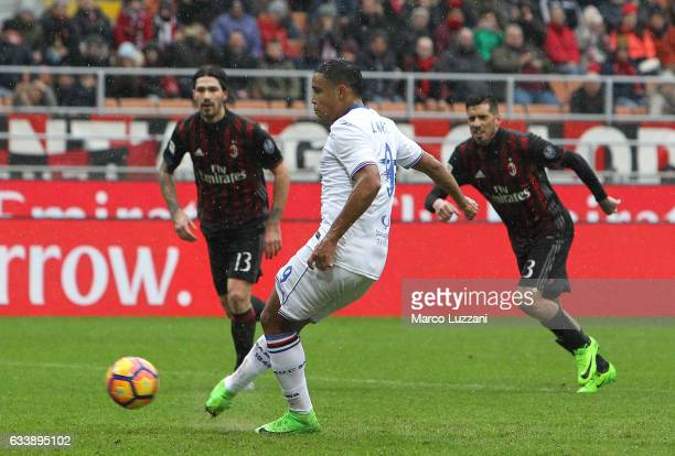 Luis Fernando Muriel of UC Sampdoria scores the opening goal from the penalty spot during the Serie A match between AC Milan and UC Sampdoria at...
