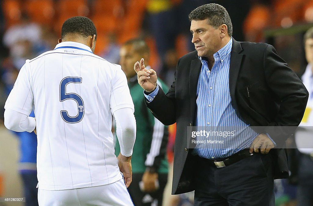 Luis Fernando Suárez, manager of the Honduras national team talks with Victor Bernandez #5 during an international friendly match at BBVA Compass Stadium on November 19, 2013 in Houston, Texas.