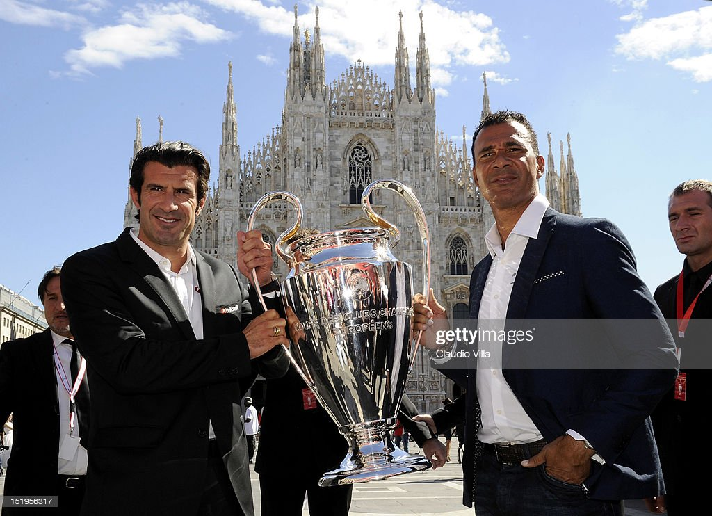 <a gi-track='captionPersonalityLinkClicked' href=/galleries/search?phrase=Luis+Figo&family=editorial&specificpeople=201507 ng-click='$event.stopPropagation()'>Luis Figo</a> (L) and <a gi-track='captionPersonalityLinkClicked' href=/galleries/search?phrase=Ruud+Gullit&family=editorial&specificpeople=2104975 ng-click='$event.stopPropagation()'>Ruud Gullit</a> pose with the UEFA Champions League trophy outside the Duomo di Milano (Milan Cathedral) on September 13, 2012 in Milan, Italy.
