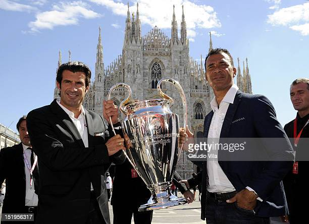 Luis Figo and Ruud Gullit pose with the UEFA Champions League trophy outside the Duomo di Milano on September 13 2012 in Milan Italy