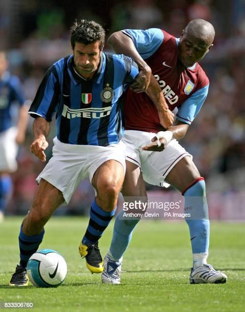 Luis Figo battles with Nigel ReoCoker during a friendly match between Aston Villa and Inter Milan at Villla Park Birmingham PRESS ASSOCIATION Photo