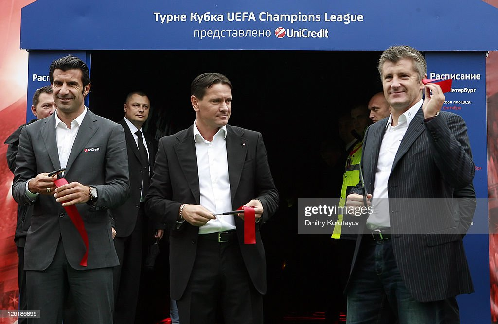 Luis Figo, Dmitri Alenichev and Davor Suker cut tape during opening ceremony of the UEFA Champions League Trophy Tour 2011 on September 23, 2011 in Moscow, Russia.