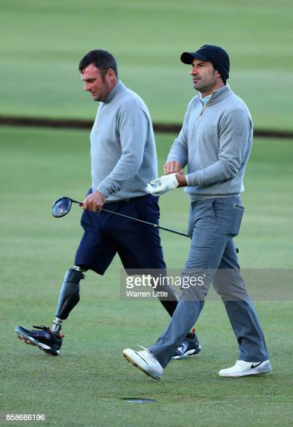 Luis Figo former football player walks down the fairway with Ian Bishop during day three of the 2017 Alfred Dunhill Championship at The Old Course on...