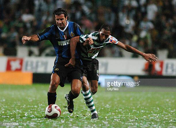 Luis Figo left playing with Inter Milan and Liedson of Sporting during the 100th anniversary match between Sporting Lisbon and Inter Milan in Lisbon...