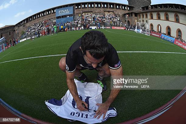Luis Figo of AC Milan Inter Legends signs autographs during the Ultimate Champions Match between Milan Inter Legends and World AllStars during the...