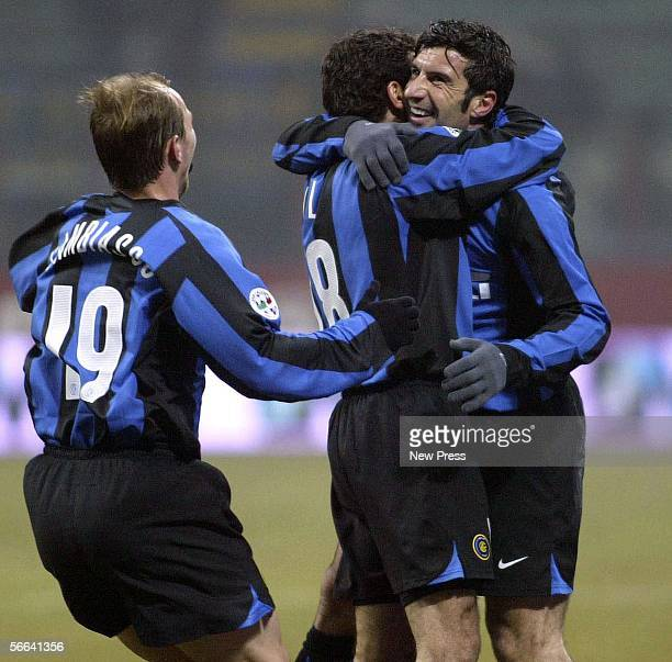 Luis Figo of Inter Milan celebrates with team mates after scoring during the Serie A match between Inter Milan and Palermo at the Giuseppe Meazza San...