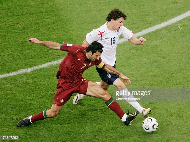 Luis Figo of Portugal battles for the ball with Owen Hargreaves of England during the FIFA World Cup Germany 2006 Quarterfinal match between England...