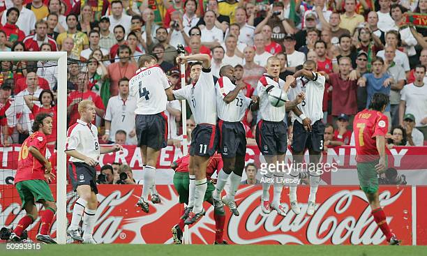 Luis Figo of Portugal fires a free kick into the England wall during the UEFA Euro 2004 Quarter Final match between Portugal and England at the Luz...
