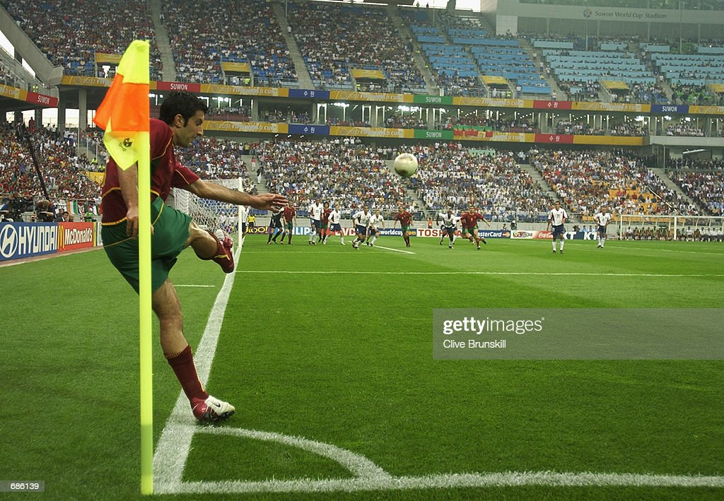Luis Figo of Portugal takes a corner during the second half of the Portugal v USA Group D World Cup Group Stage match played at the Suwon World Cup...