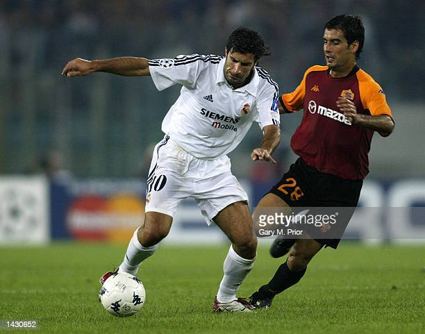 Luis Figo of Real Madrid holds off Josep Guardiola of Roma during the UEFA Champions League First Phase Group C match between AS Roma and Real Madrid...
